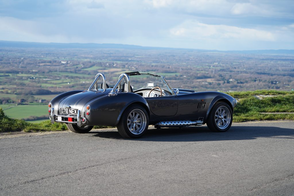 Caption: One of our factory-built Cobras in the picturesque Devil's Dyke.