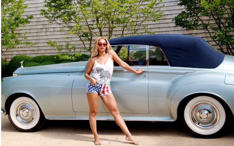 Beyonce leaning on her 1959 Rolls-Royce Silver Cloud Convertible