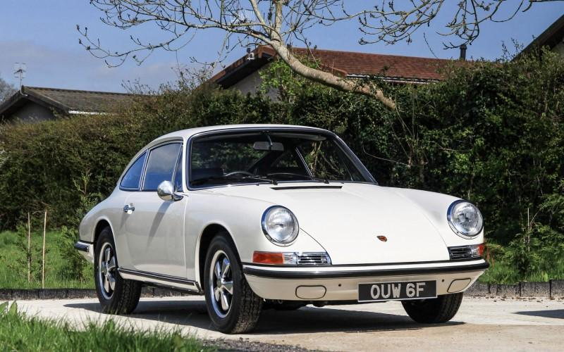 White Classic 911 showing off on a sunny day