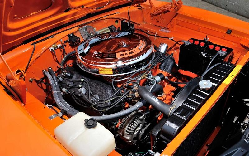 426 Hemi engine mounted on an orange 1969 Dodge Charger 500